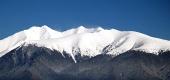 Vrcholky Roháčov pokryté snehom