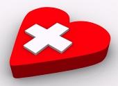 Koncept. Srdce a kríž na bielom pozadí