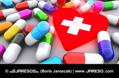 Pilulky a žiariace červené srdce